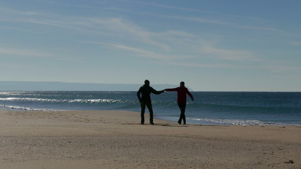 Happy Middle-aged Couple Walking on Ocean Sandy Beach