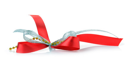 Red ribbon and bow gift box on a white background