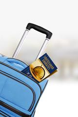United Arab Emirates. Blue suitcase with guidebook.