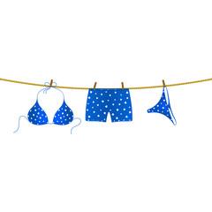 Bikini and boxer shorts hanging on rope