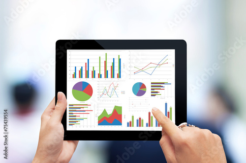 hand holding digital tablet with analyzing graph - 75439554