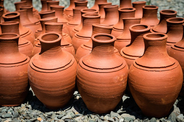 Turkish clay pots in market outdoor in sunny day