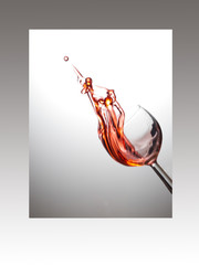 Wine glass with rose splash in frame