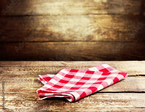 red tablecloth on wooden background - 75441512