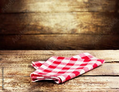 Leinwandbild Motiv red tablecloth on wooden background