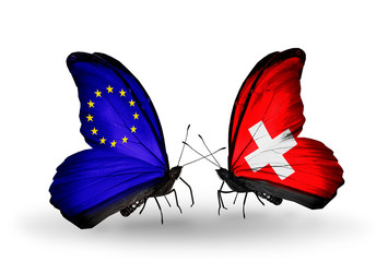 Two butterflies with flags EU and Switzerland