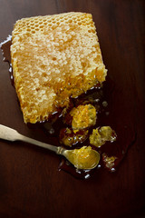 Honey and honeycomb on a wooden table