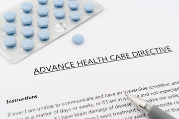 advance health care directive with blue pills ans grey pen