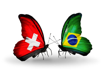 Two butterflies with flags Switzerland and Brazil