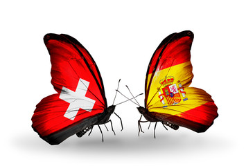 Two butterflies with flags Switzerland and Spain