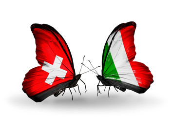 Two butterflies with flags Switzerland and  Italy
