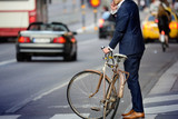 Fototapety Man in perfect suit and old bike, typical Stockholm Scene