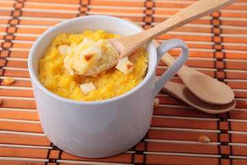 Spoon of polenta baked with cheese