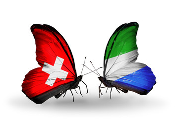 Two butterflies with flags Switzerland and Sierra Leone