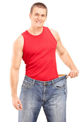Happy guy posing in a pair of oversized jeans
