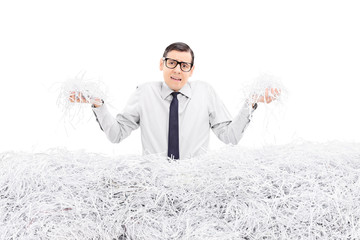 Powerless employee holding bunch of shredded paper