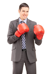 Competitive businessman with boxing gloves