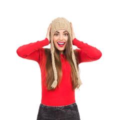 Surprised girl in winter cap