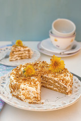 Layered honey cake with chantilly cream