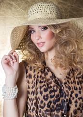 sexy woman in dress leopard bright makeup in the hat