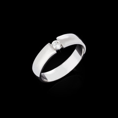 Engagement diamond ring on black background