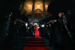 Leinwanddruck Bild - woman in red dress on the red carpet photos of paparazzi