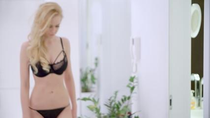 Sensual Blond Girl Walking in Lingerie