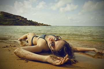 Lying at the beach