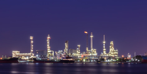 Oil refinery plant illuminated at twilight