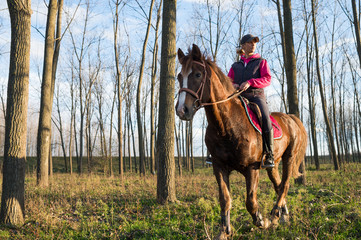 Girl riding a horse