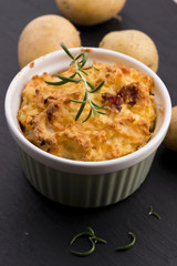 dish of potato souffle with rosemary