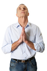 Portrait of a man praying to God