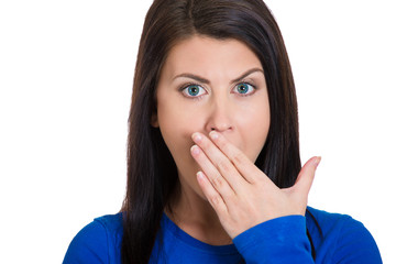 sleepy young woman placing hand on mouth yawning annoyed