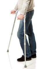 Close up on male legs with crutches