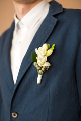 boutonniere on suit of the groom