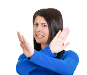 angry young woman with X gesture to stop talking, cut it out