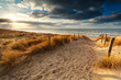 canvas print picture - sunset over sand path to North sea