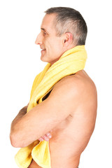 Side view mature man holding towel around neck