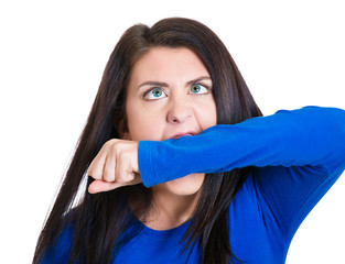 crazy, angry, looney young business woman biting her hand