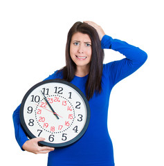 woman worker holding clock looking anxiously, lack of time