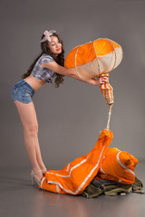 sexy girl in style pinup gets orange jellyfish of parachute