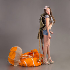 girl in style pinup stands near jellyfish of  parachute