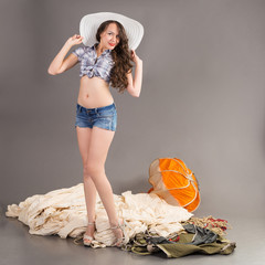 sexy girl posing near dissolution of the old parachute