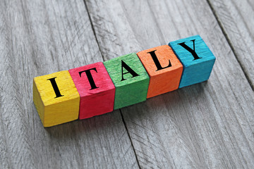 word italy on colorful wooden cubes
