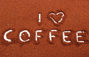 Coffee word written on ground coffee