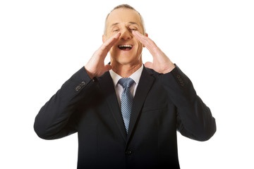 Portrait of businessman calling for someone