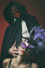 Mysterious couple wearing venetian masks