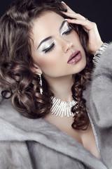 Beauty Makeup. Fashion Girl Portrait. Model in Mink Fur Coat. Wi