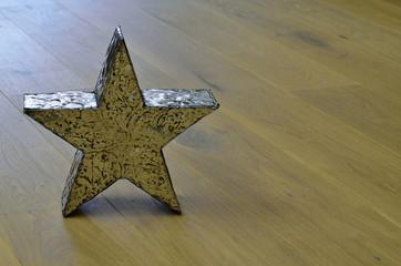 Metal star on wooden floor