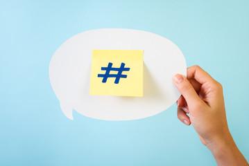 Social media hashtag on blue background